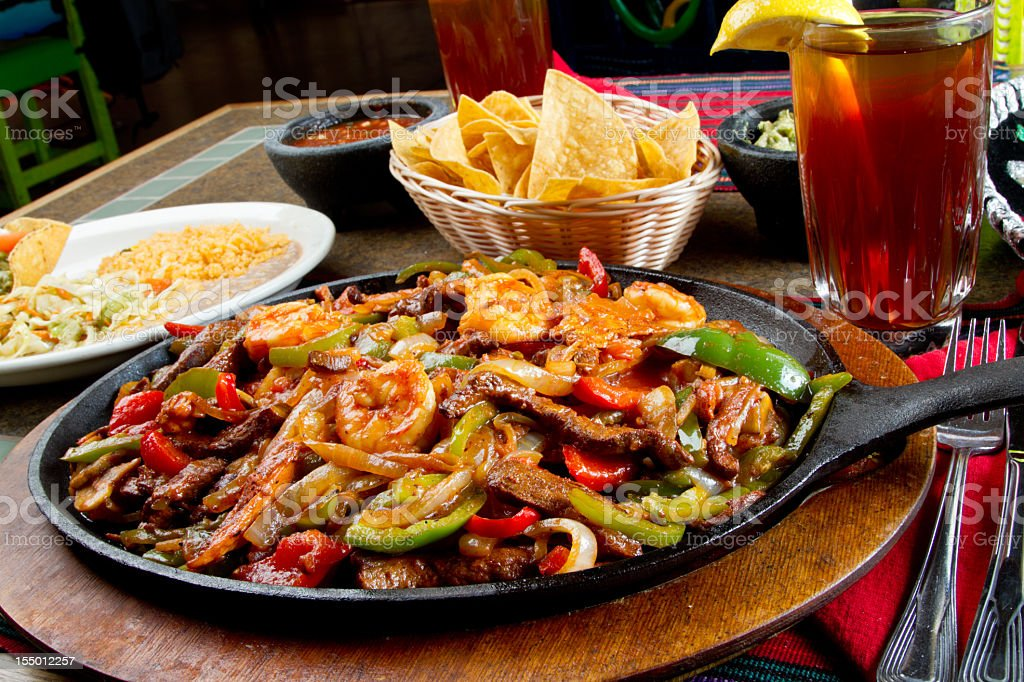 Shrimp, Beef and Chicken Mexican Fajitas royalty-free stock photo