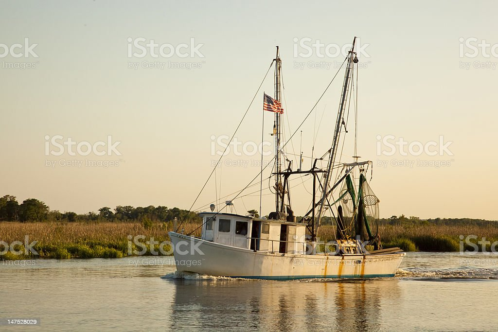 Shrimp Boat at Dusk stock photo