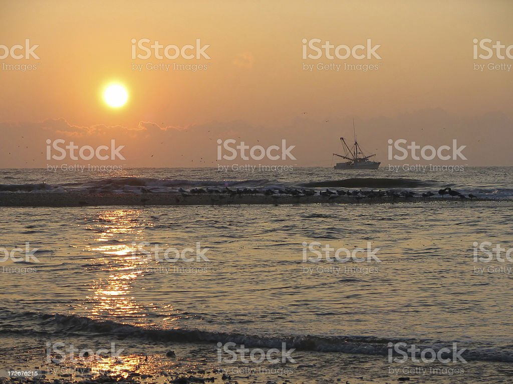 Shrimp boat at sunrise stock photo