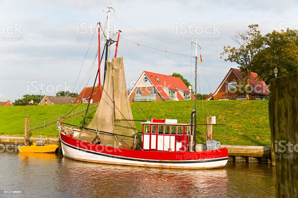 Shrimp boat moored in front of a dyke stock photo