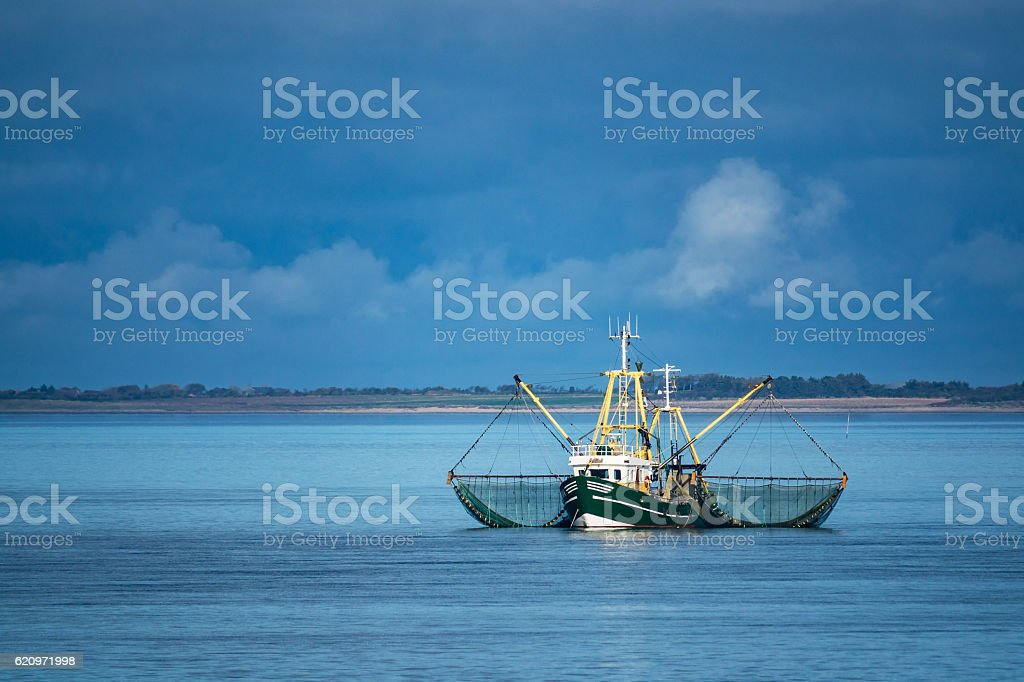 Shrimp boat on the North Sea stock photo