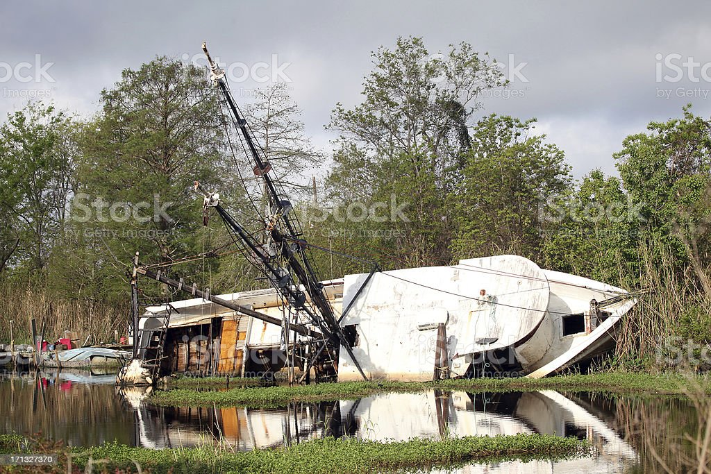 Shrimp boat wreck left from hurricane. stock photo
