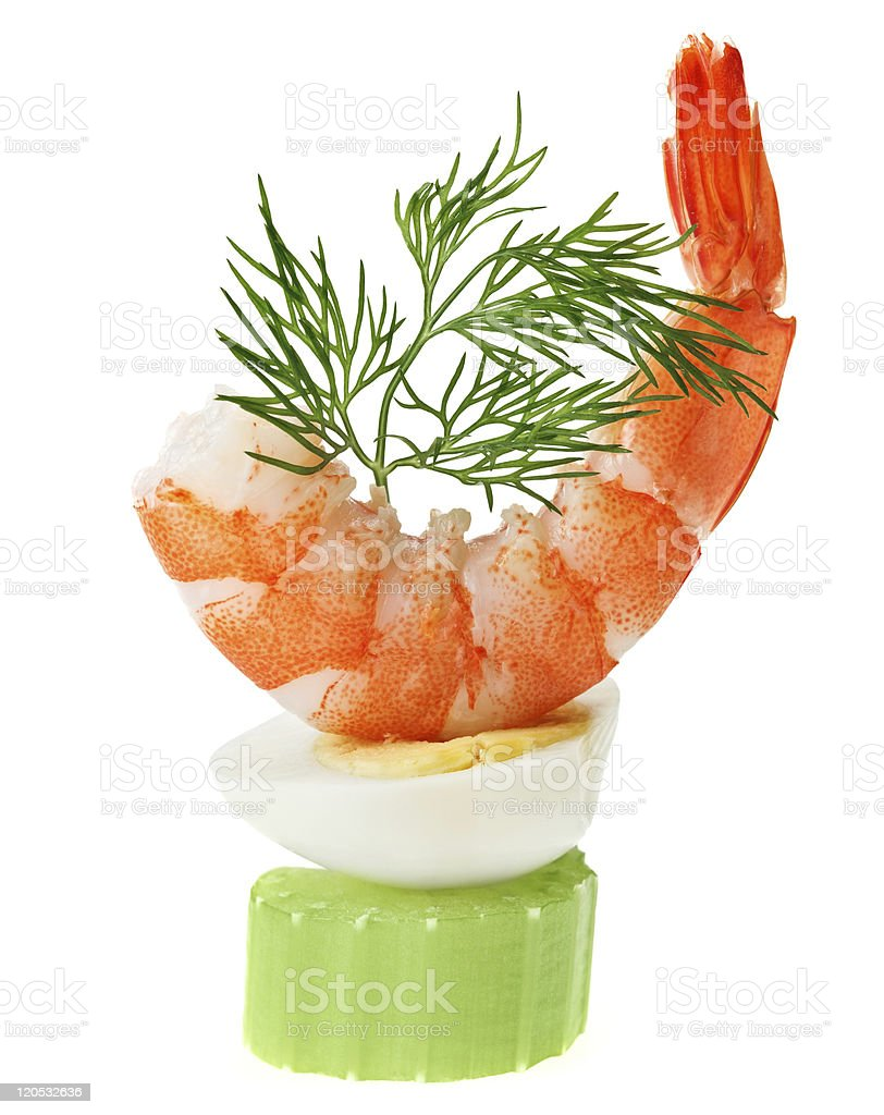 Shrimp canape with quail egg and dill twig royalty-free stock photo
