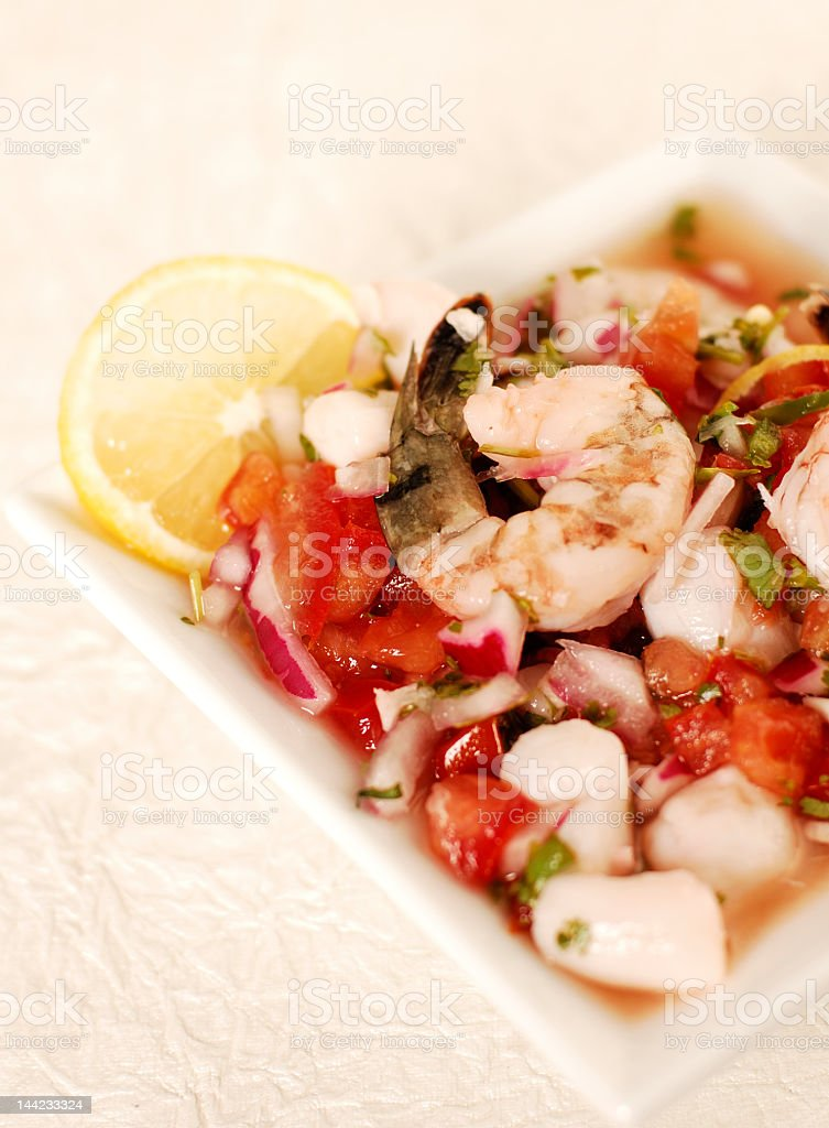 Shrimp ceviche in a white dish on a cream background  stock photo