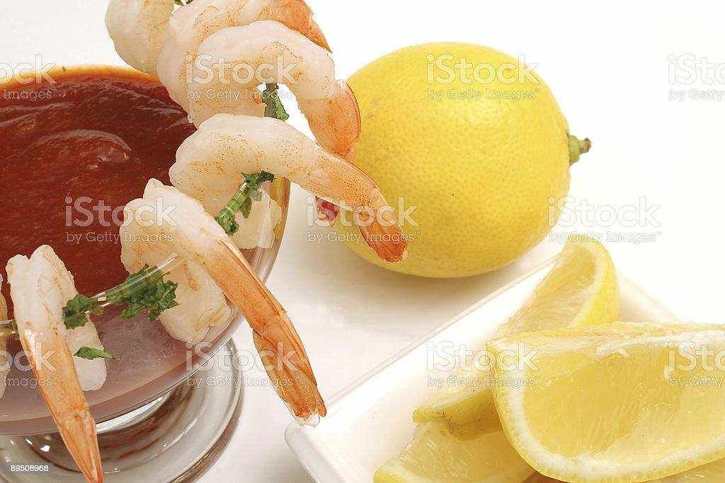 shrimp cocktail on white w/lemons royalty-free stock photo