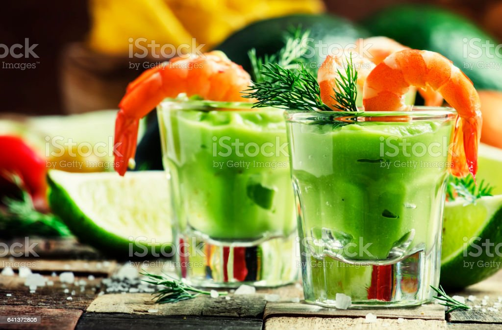 Shrimp cocktail with avocado sauce and lime stock photo