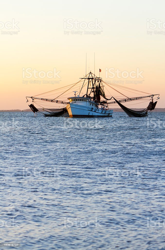 Shrimp Fishing Boat With Nets Out stock photo
