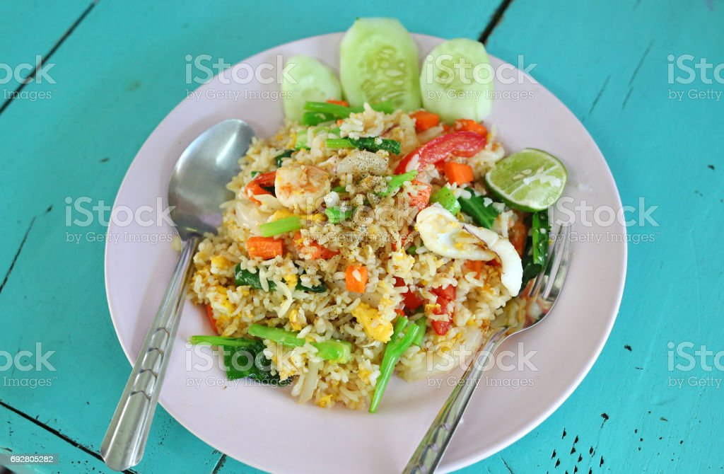 Shrimp fried rice on wood table. stock photo