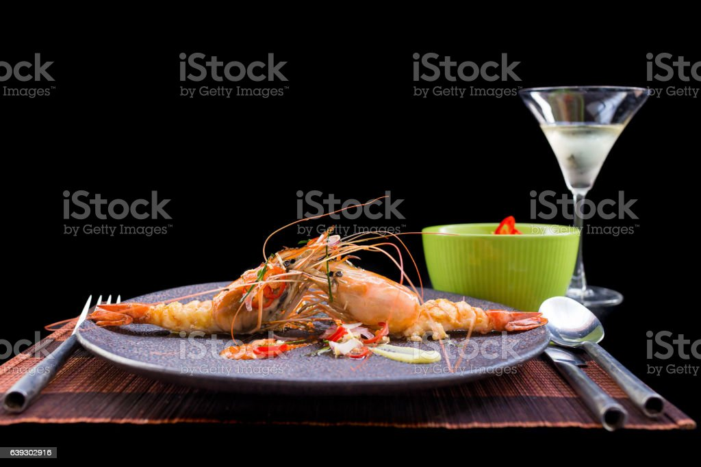 Shrimp grilled and spicy sauce on black background stock photo