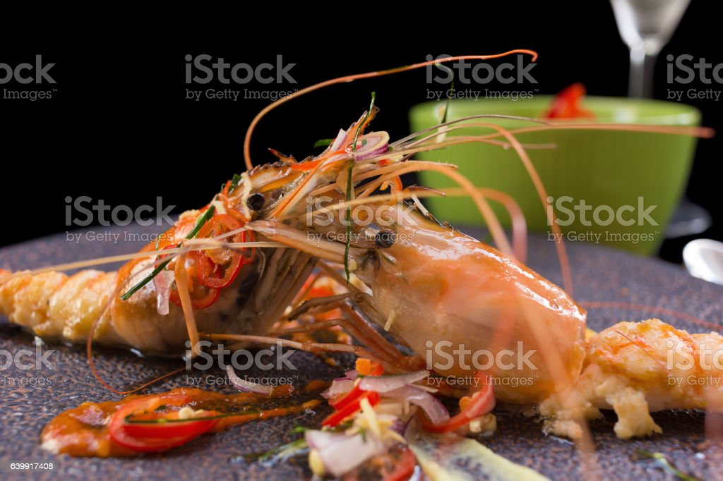 Shrimp grilled and spicy sauce on black background. stock photo