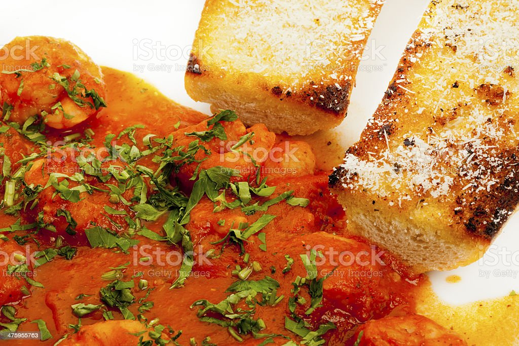 Shrimp in red tomato sauce from garlic whit bread stock photo