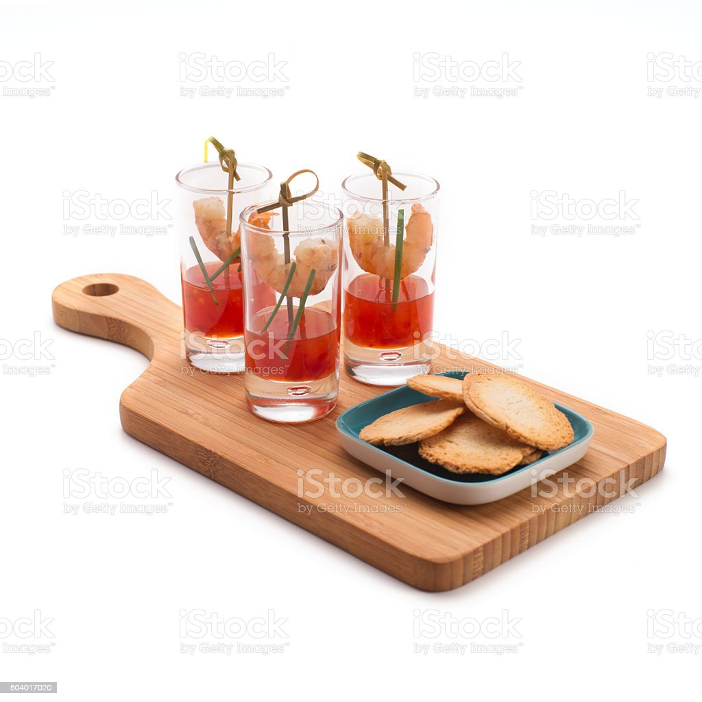 Shrimp in shot glasses with sweet and chili red sauce stock photo