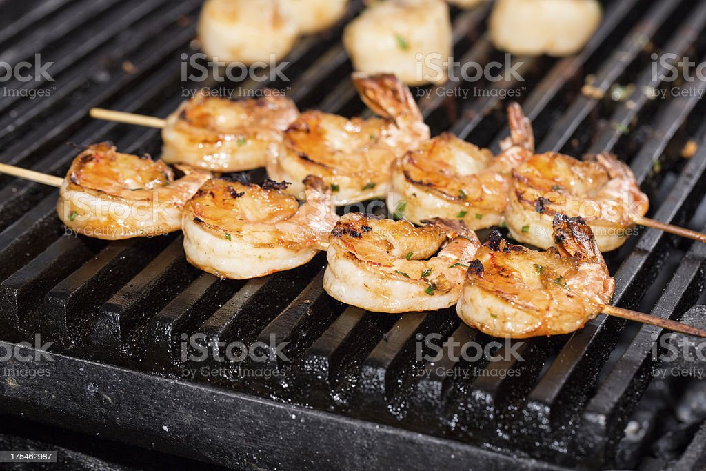 Shrimp kebabs cooking stock photo