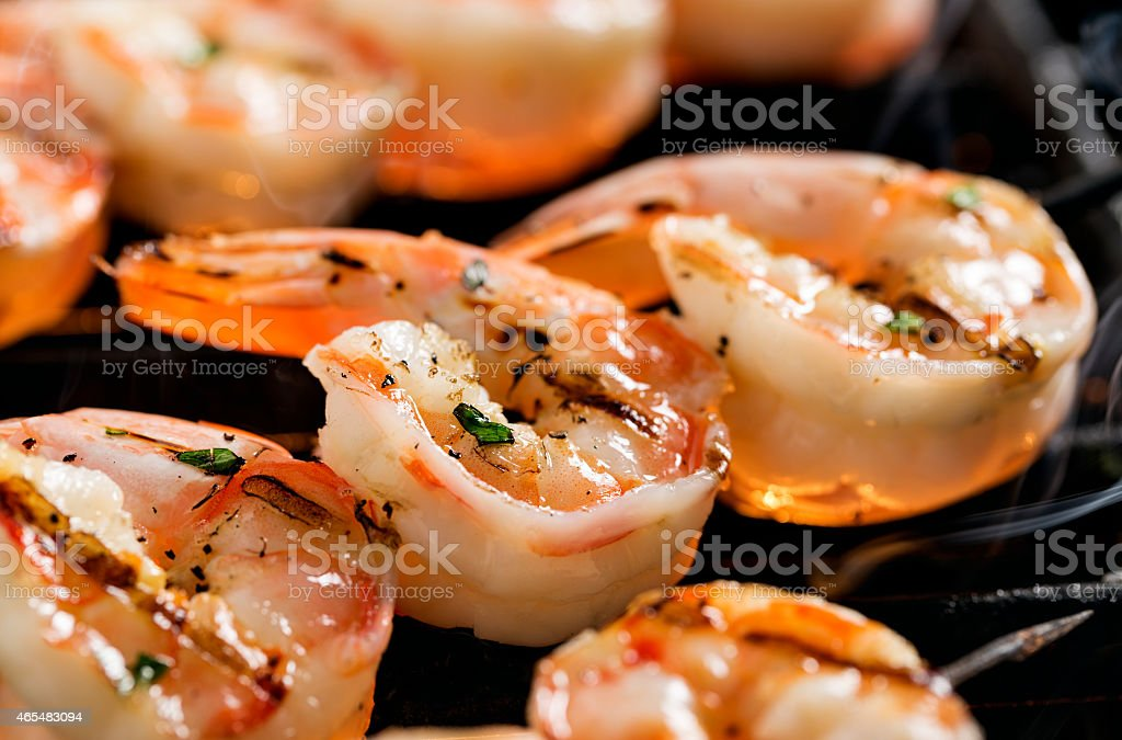 Shrimp kebabs on the grill stock photo