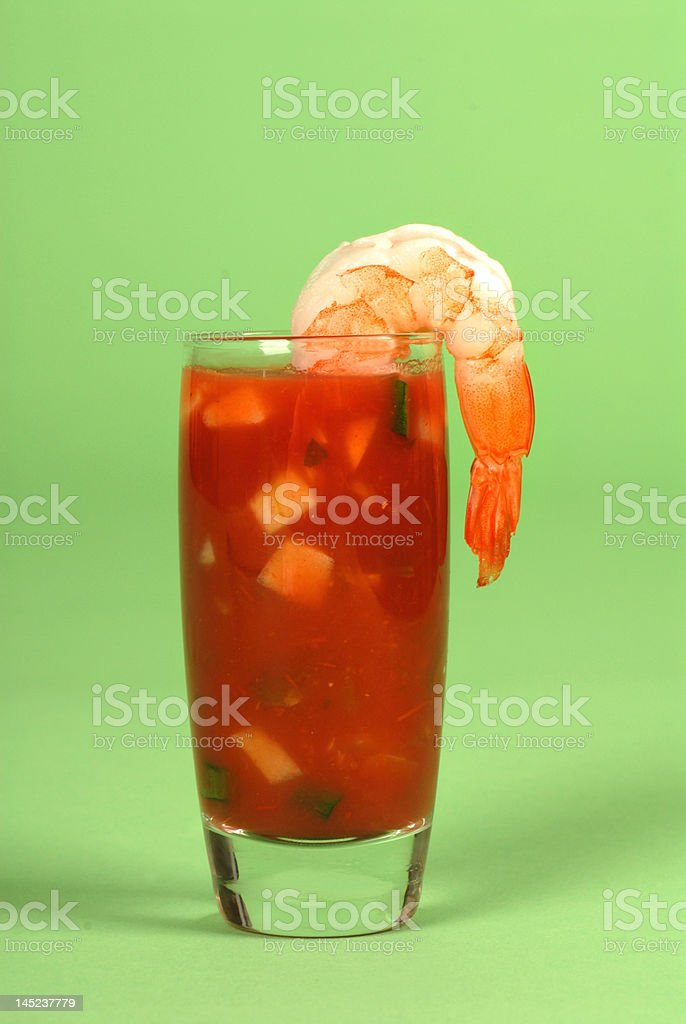 Shrimp on a glass containing with cocktail sauce stock photo