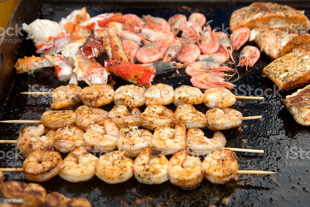 Shrimp on Skewers with King Crab and Salmon Filet stock photo