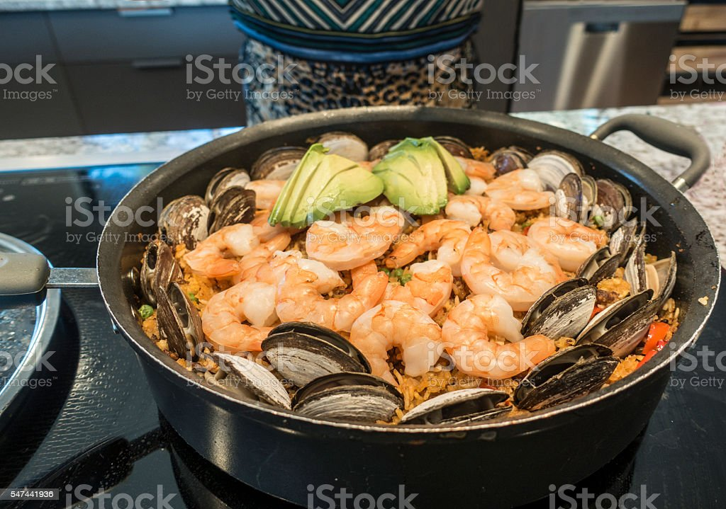 Shrimp Paella in Kitchen Saute Pan On Stove stock photo