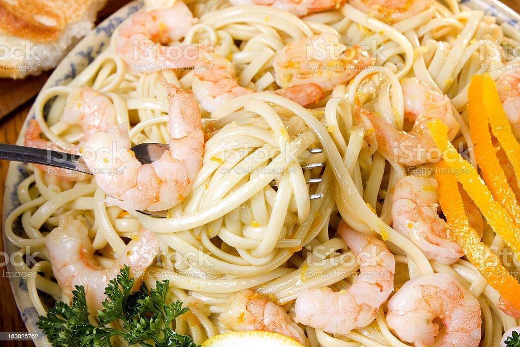 Shrimp pasta with a organge and lemon garlic sauce. royalty-free stock photo