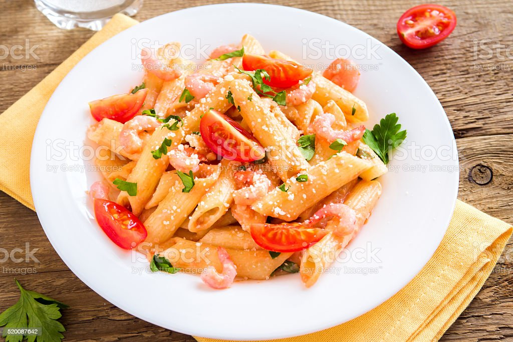 shrimp pasta with tomato sauce stock photo