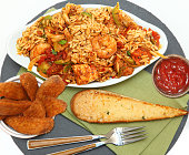 Shrimp Sausage Chicken Jambalaya with Potatoe Wedges and Garlic Bread