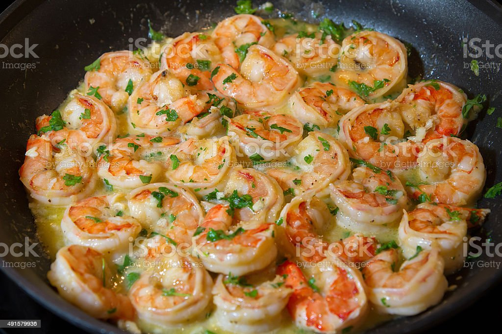 shrimp scampi sautéed in butter and garlic stock photo