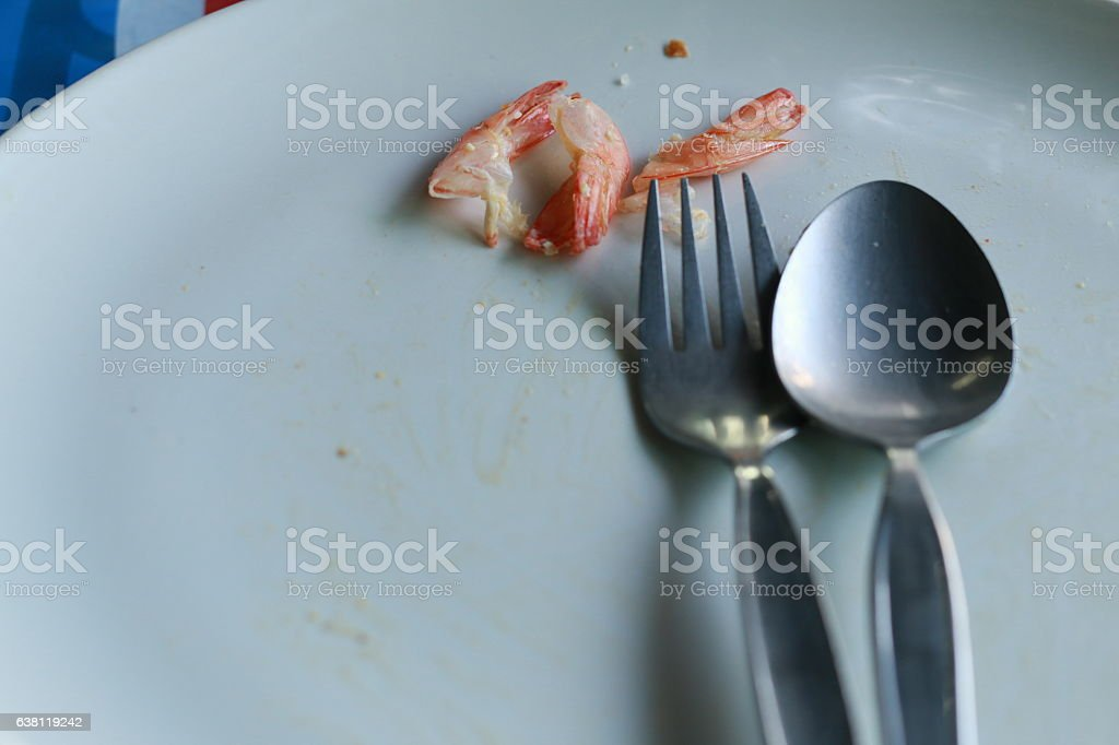 Shrimp shell fragments food on dish after stock photo