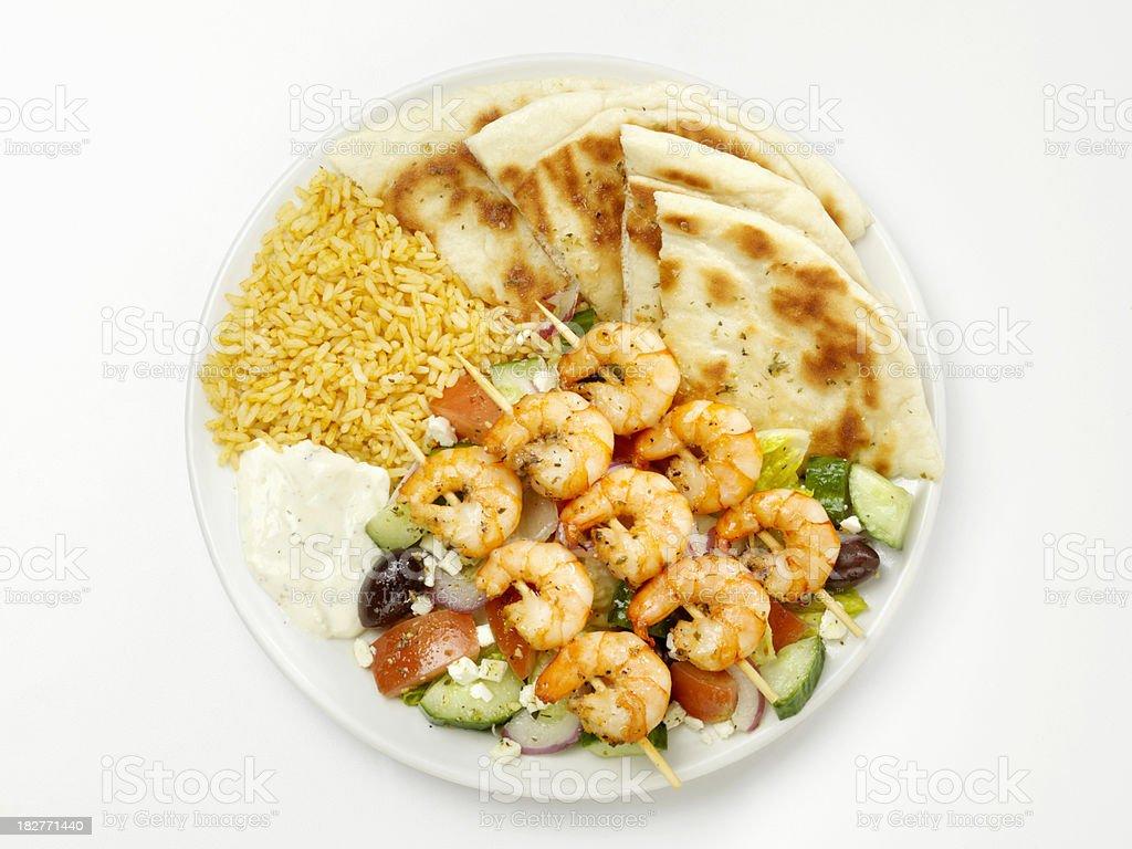 Shrimp Souvlaki with Greek Salad, Rice and Bread stock photo