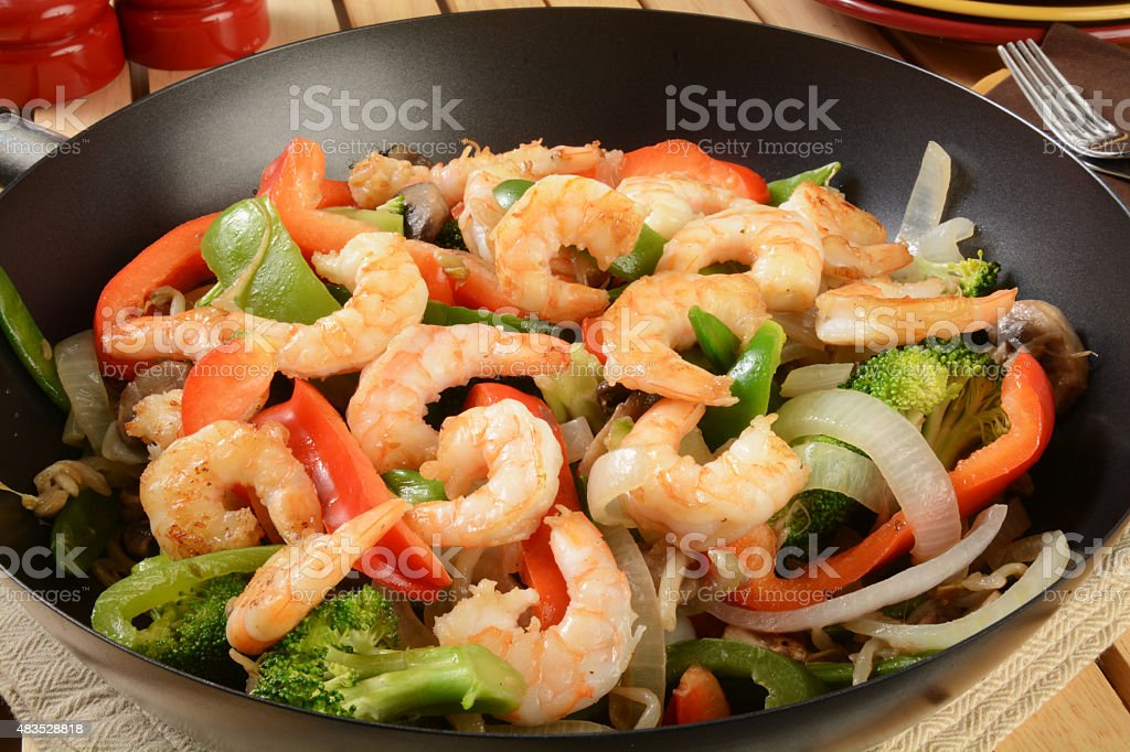 Shrimp stir fry in a wok stock photo