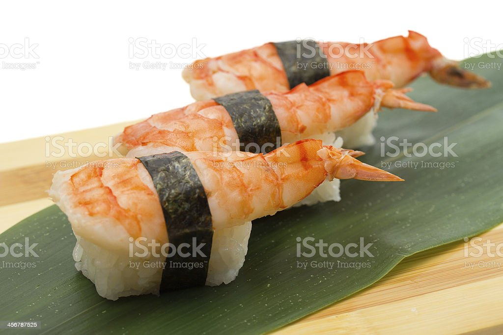 Shrimp sushi nigiri on wooden plate stock photo