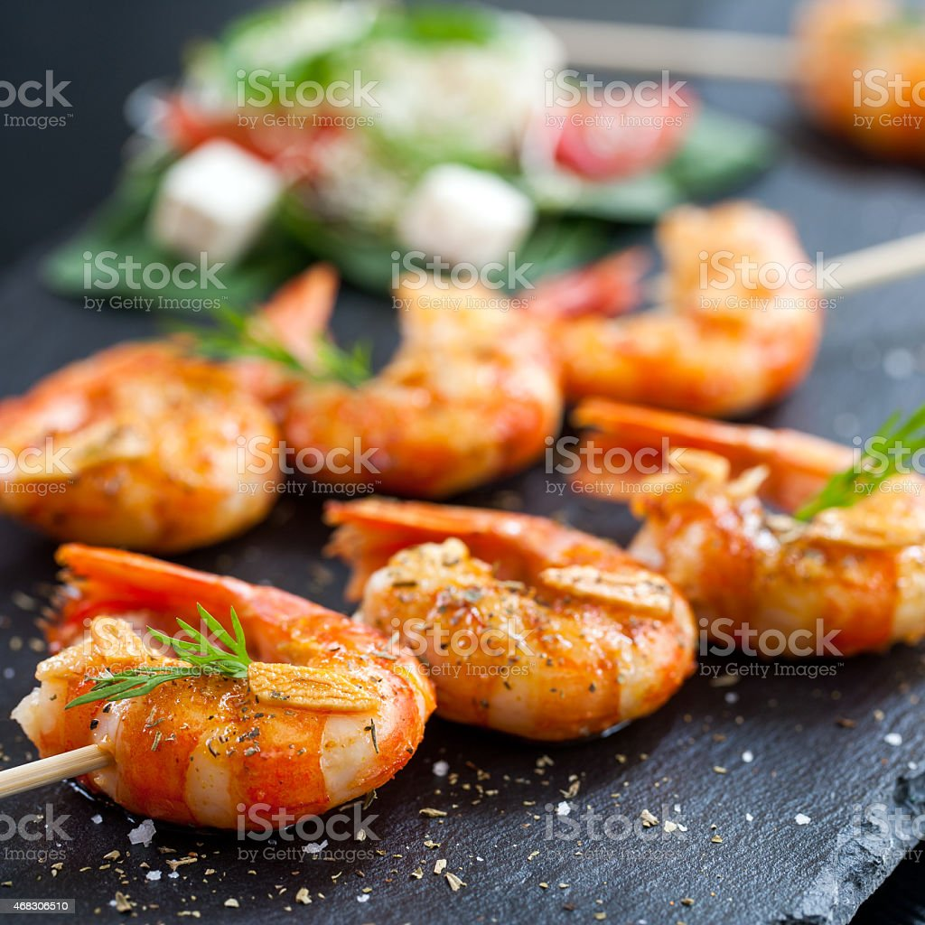 Shrimp tails grilled on wood skewer. stock photo