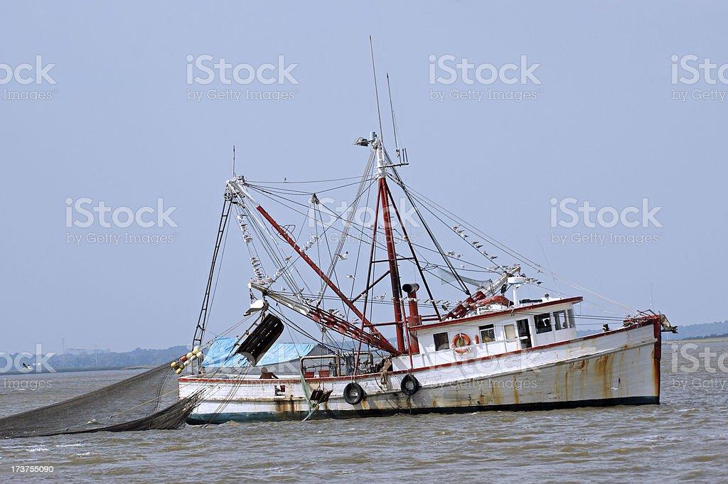 Shrimp Trawler Off Coast of Jekyll Island GA stock photo