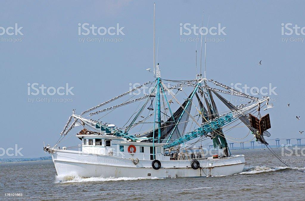 Shrimp Trawler Off Coast of Jekyll Island Georgia stock photo