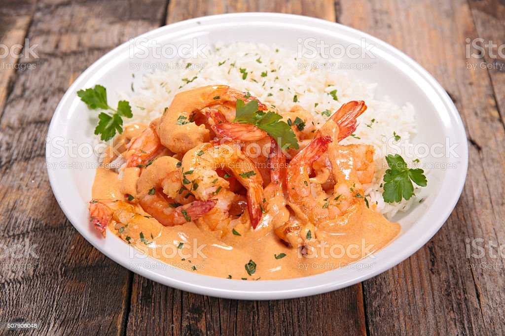shrimp with curry and coconut sauce stock photo