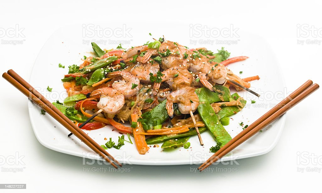 Shrimp with noodles, vegetables, and peanut sauce royalty-free stock photo