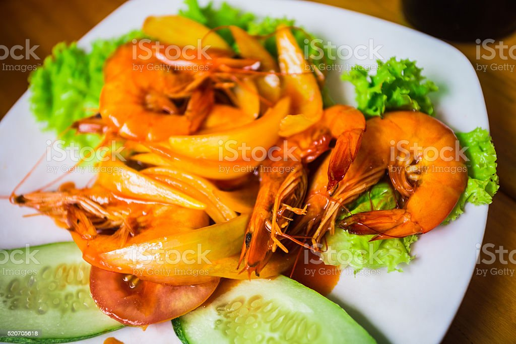 Shrimp with onions, lettuce, cucumber and sour sauce stock photo