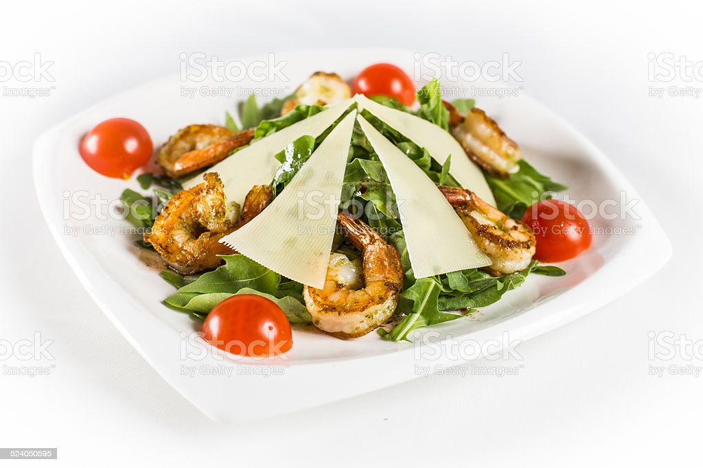 shrimp with parmesan and greens stock photo