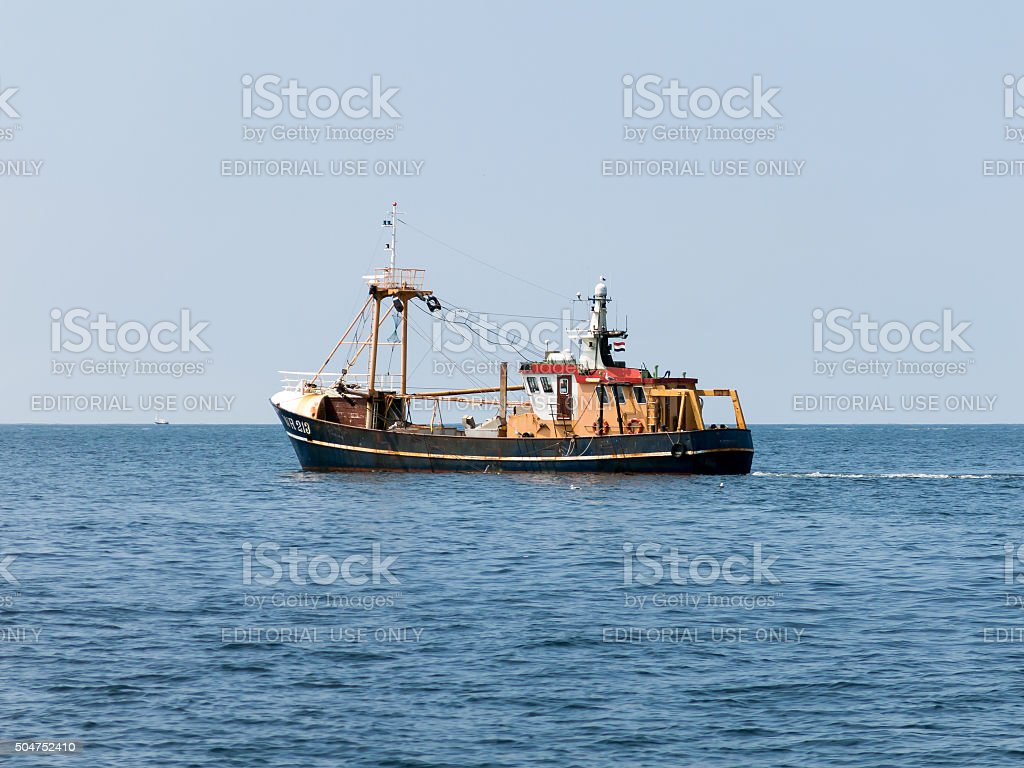Shrimper at sea, Netherlands stock photo