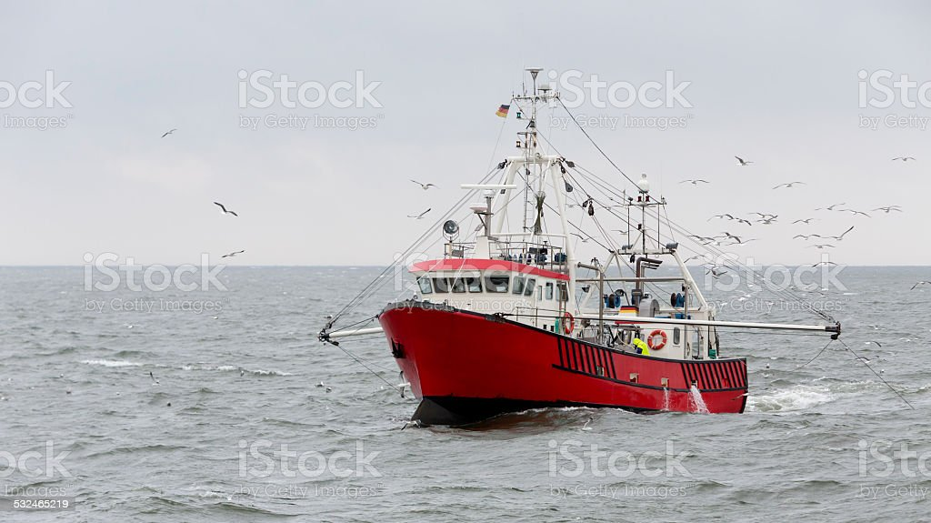 Shrimper at the North Sea not far from Helgoland (Germany) stock photo