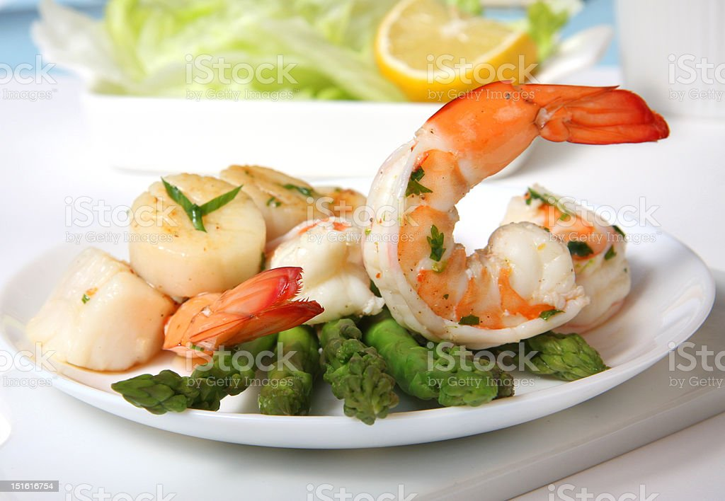 Shrimps and scallop with asparagus stock photo