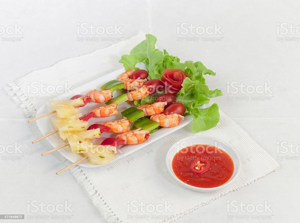 Shrimps and vegetables on barbecue sticks stock photo