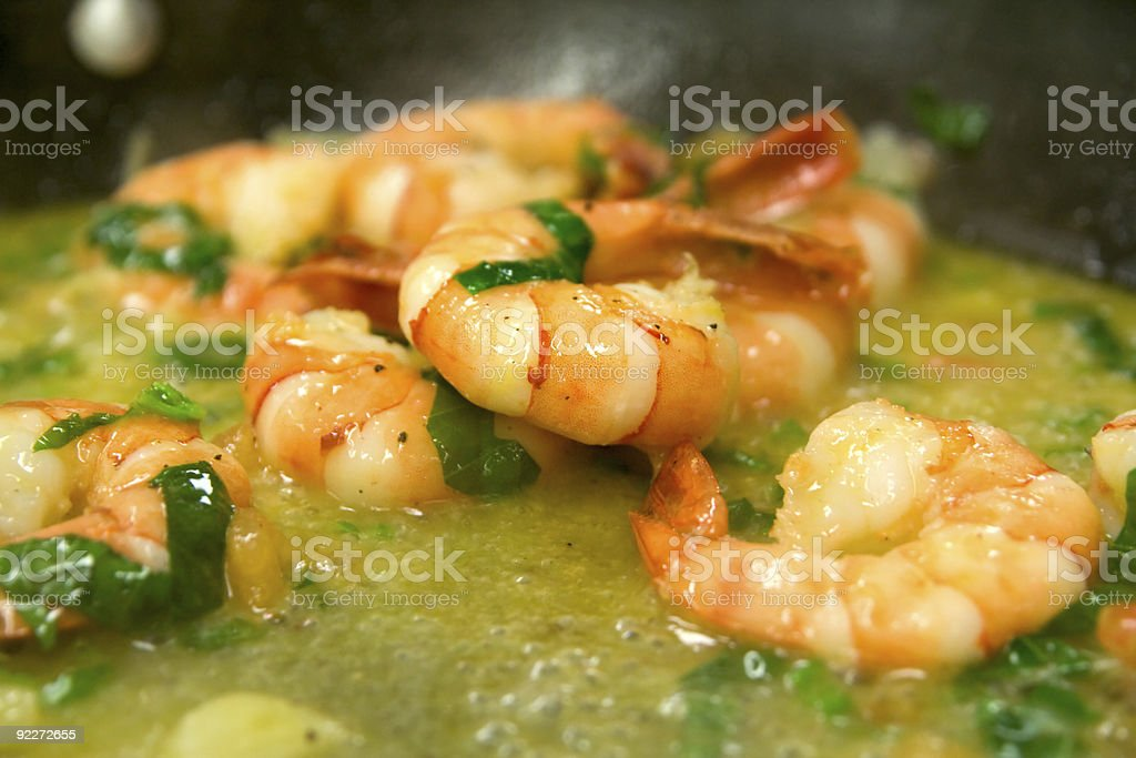 Shrimps are fried in butter and olive oil with herbs royalty-free stock photo