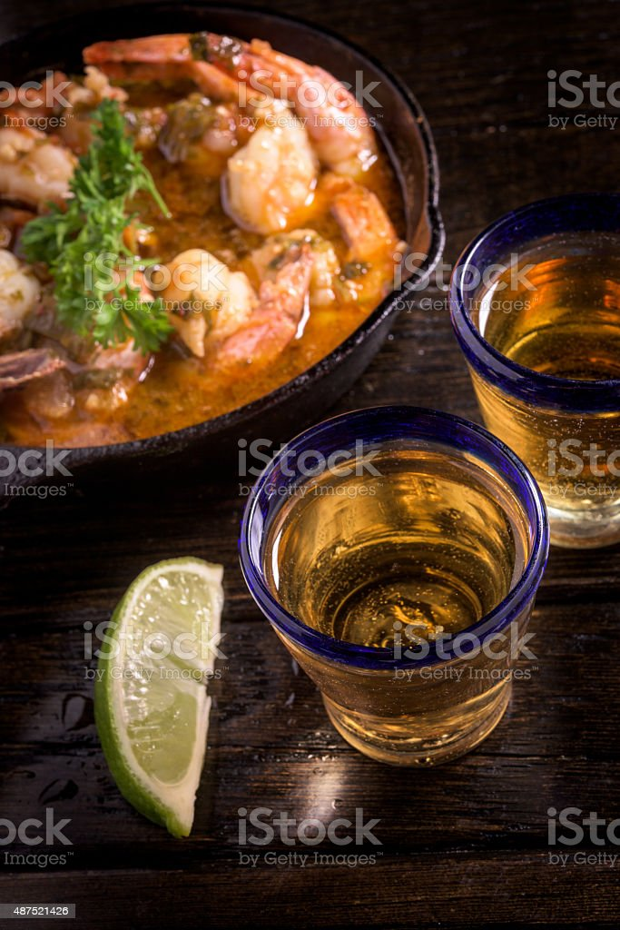 Shrimps Casserole and Tequila Appetizer stock photo