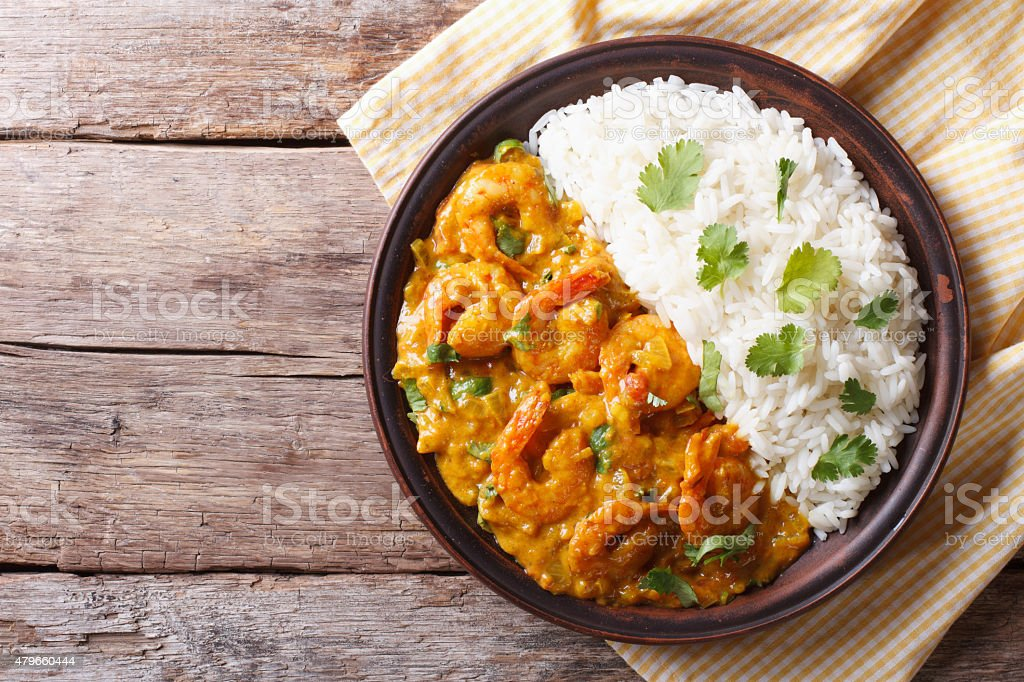 Shrimps curry with rice on plate. horizontal view from above stock photo
