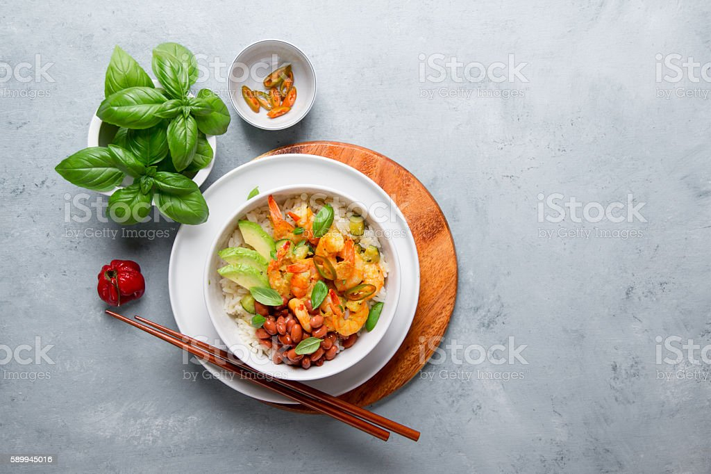 Shrimps in curry sauce and rice stock photo