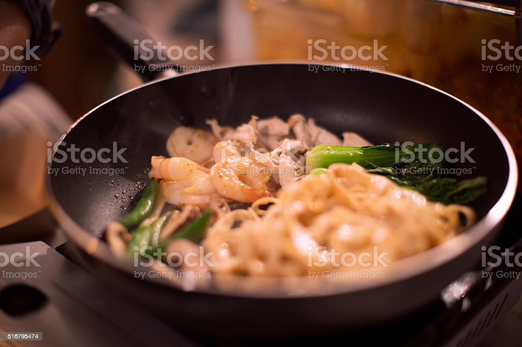 Shrimps Noodle in Saute pan stock photo