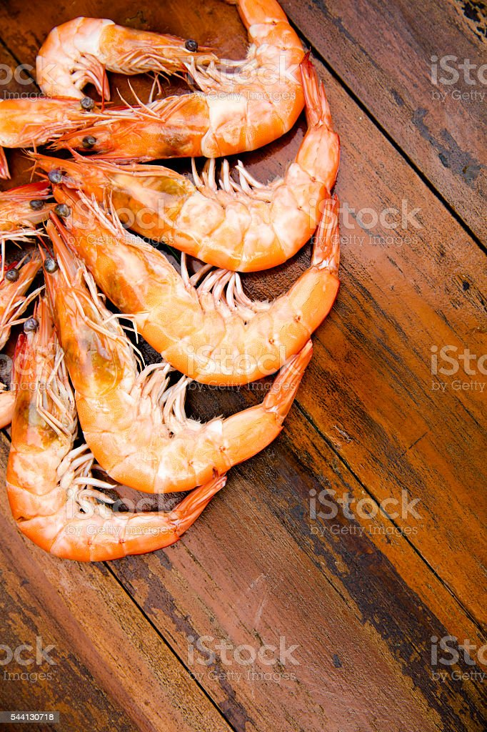 Shrimps on a wooden table stock photo