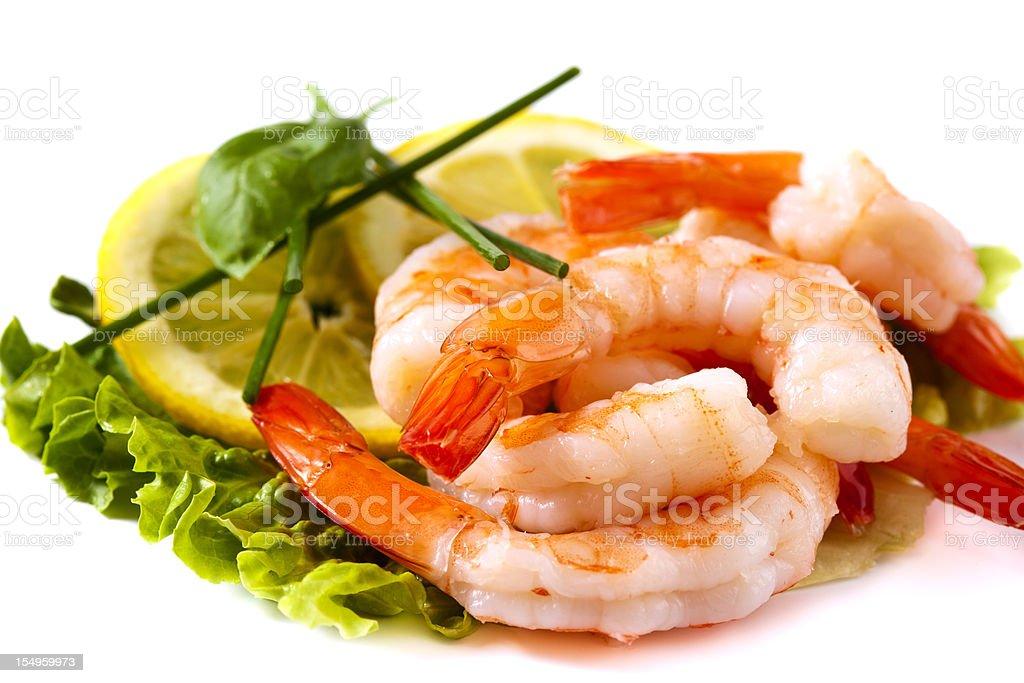 Shrimps on lettuce with lemon stock photo