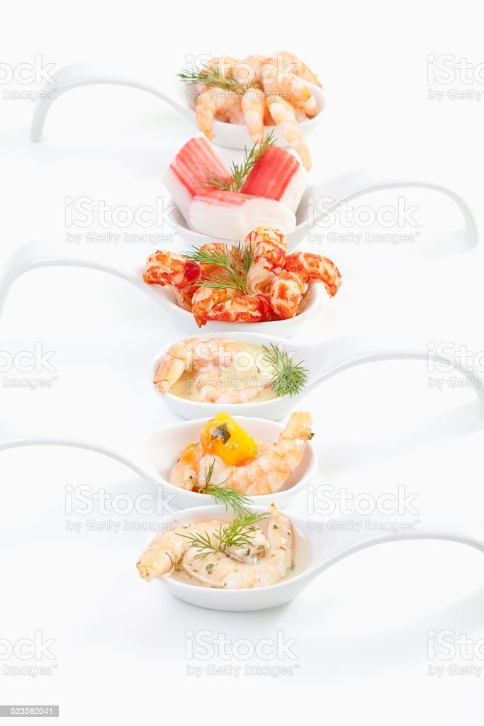 Shrimps on spoon, elevated view stock photo