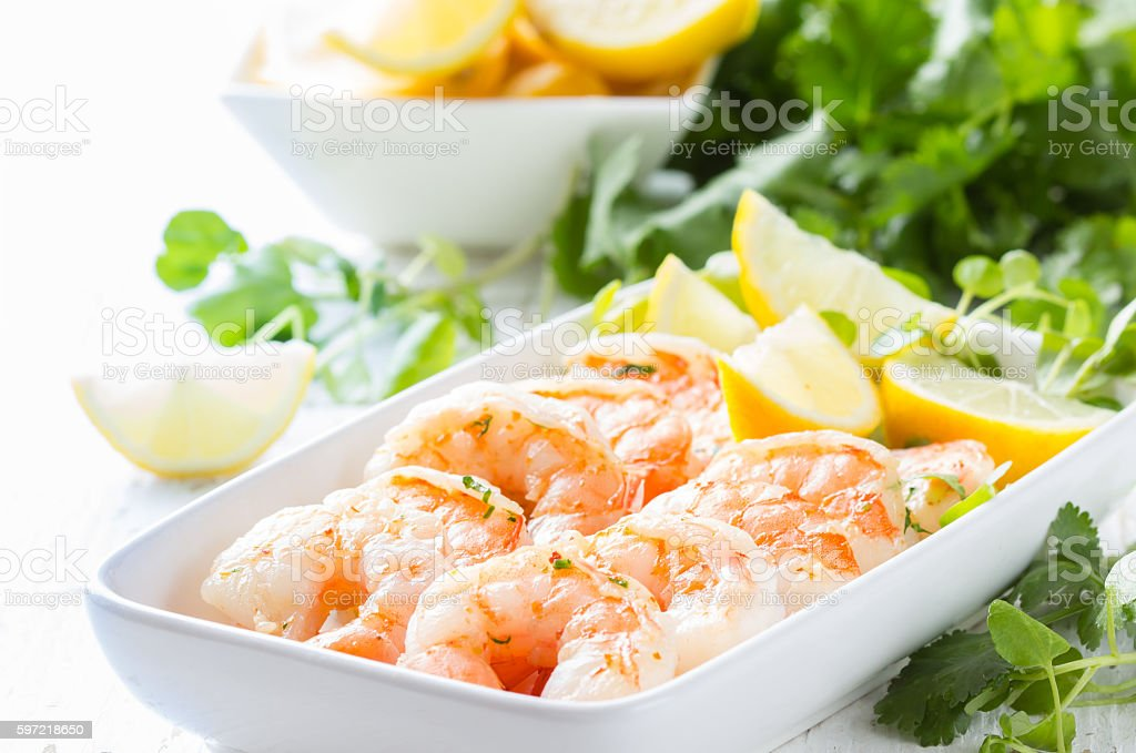 Shrimps prawns with fresh herbs and lemon stock photo