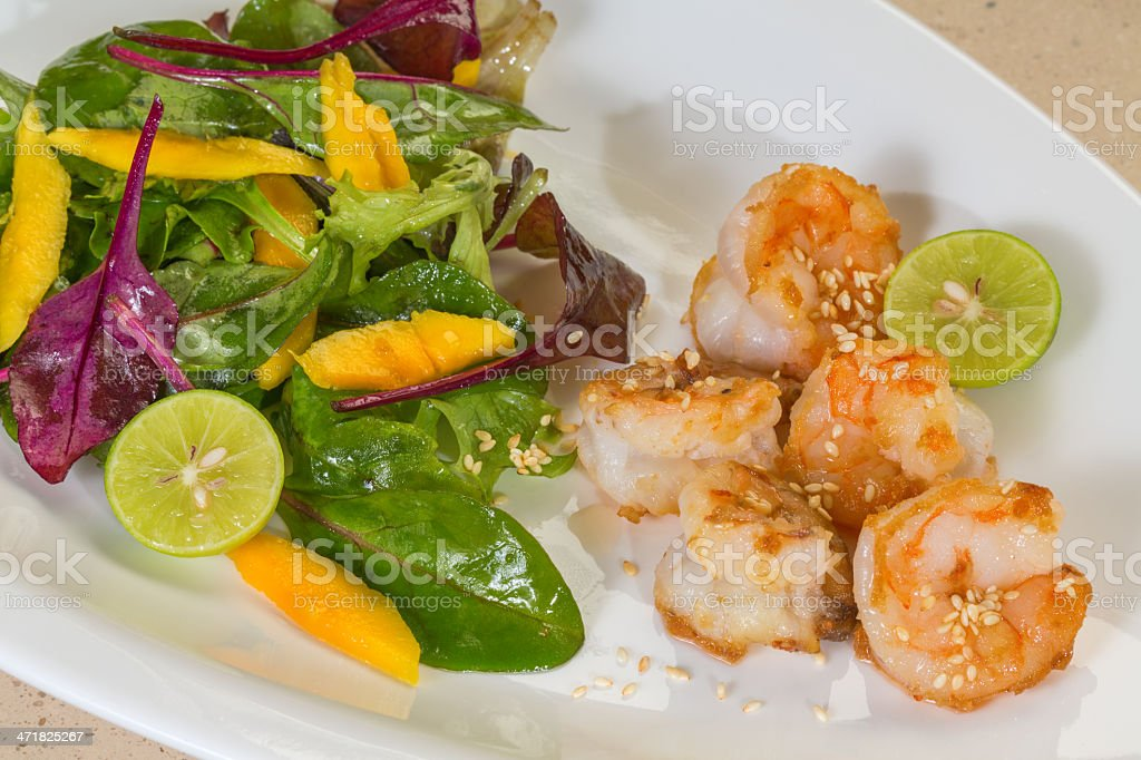 Shrimps salad with mango, and toasted sesame royalty-free stock photo